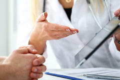 Female medicine doctor hands hold and show digital tablet pc Royalty Free Stock Photography