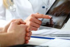 Female medicine doctor hands hold and show digital tablet pc. To patient explaining diagnosis. Physical, disease prevention, 911, prescribe remedy, healthy Stock Photos