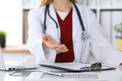 Female medicine doctor offering helping hand in office closeup. Physician ready to examine and save patient. Friendly. And cheerful gesture. Medical cure and Stock Photo