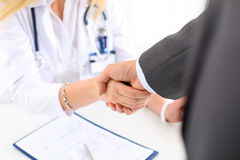 Female medicine doctor shake hand as hello royalty free stock images