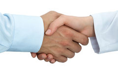 Female medicine doctor shaking hands with male patient. Partnership, trust and medical ethics concept. Handshake with satisfied client. Healthcare and medical stock photo