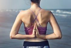 Female Meditating Yoga Pose Beach Concept Stock Image