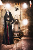 Female member of Royalty standing by golden throne Royalty Free Stock Photography