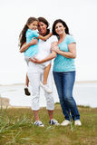 Female Members Of Multi Generation Family Standing By Sea Stock Image
