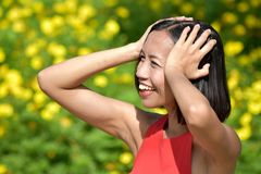 A Female Memory Problems. An attractive and asian person stock photography
