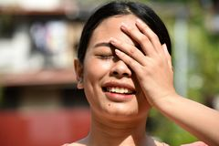 Female Memory Problems. An attractive young asian person royalty free stock photography