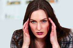 Female with migraine or stress Royalty Free Stock Photo