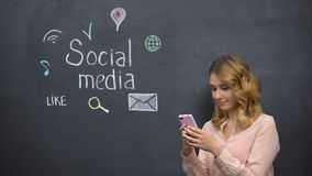 Female millennial chatting in social media using cell phone, globalization. Stock footage stock video footage