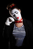 Female mime artist. Over black background Royalty Free Stock Photography