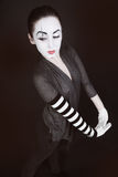 Female mime in  gray jacket Royalty Free Stock Image