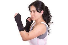 Female mixed martial arts fighter wearing MMA. Style gloves . This image has attached release Royalty Free Stock Photo