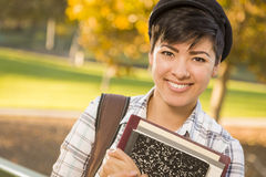 Female Mixed Race Student Holding Books Stock Images
