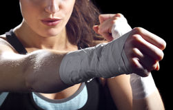 Female MMA Fighter. Punching.  black background Royalty Free Stock Image