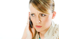 Female mobile worries. Face of beautiful blond woman talking on the phone, looking worried Stock Images