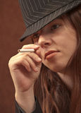 Female Mobster Having a Smoke Royalty Free Stock Image