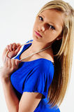 Female model. Young female fashion model leaning back in a blue dress against a white back ground Stock Images