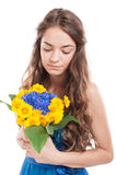 Female model admiring a bouquet of flowers Royalty Free Stock Image
