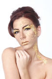 Female Model Adorned with Gold Leaf Cosmetics Stock Images