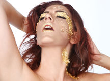 Female Model Adorned with Gold Leaf Cosmetics Royalty Free Stock Image