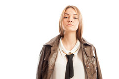 Female model with attitude wearing brown leather jacket Royalty Free Stock Image