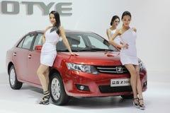 Female model in auto show Stock Image