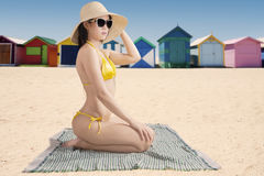 Female model with the beach cottage Stock Photos