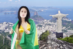 Female model with bikini and flag of Brazil Stock Photos