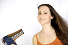 Female model blow drying her long brunette hair Royalty Free Stock Photos