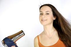 Female model blow drying her long brunette hair Royalty Free Stock Photos