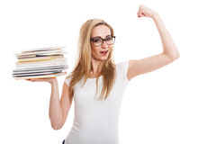 Female model carrying books doing thumbs up sign Royalty Free Stock Image