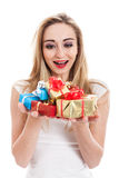 Female model carrying presents Royalty Free Stock Images