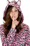 Female model in cat pajamas finger to her mouth Royalty Free Stock Photos