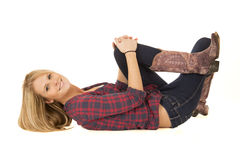 Female model in cowboy boots laying down Stock Images
