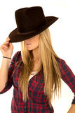 Female model in cowboy hat tipped down eyes hidden Stock Photo