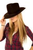 Female model in cowboy hat tipped down eyes hidden Stock Photo