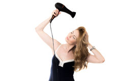 Female model drying her hair with hairdryer Royalty Free Stock Photo