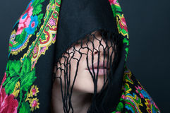 Female model with face covered by scarf Royalty Free Stock Images