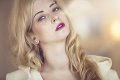 Female model with freckles on her face with pink lips closeup po Stock Images
