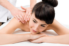 Female model getting a massage Stock Photos