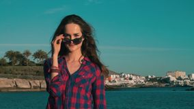 Female model girl comes closer and appraisingly look stock footage