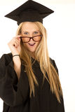 Female model in graduate attire close up peering o Royalty Free Stock Image