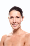 Female model with hair tied back smiling Royalty Free Stock Images
