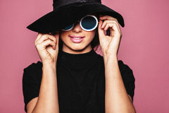 Female model with hat and stylish sunglasses Stock Photography