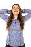 Female model with her arms behind her head stretching smiling Stock Photo