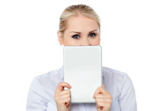 Female model hiding face with tablet pc Royalty Free Stock Photo
