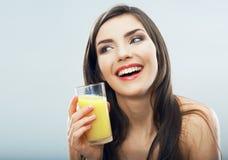 Female model hold orange juice glass isolated . Woman juice glass . Female model hold orange juice glass isolated Royalty Free Stock Image