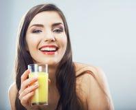 Female model hold orange juice glass isolated . Woman juice glass . Female model hold orange juice glass isolated Stock Photos