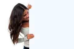 Female model holding blank white ad board Royalty Free Stock Image