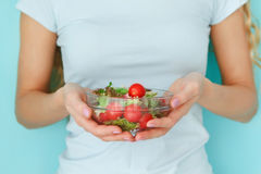 Female model holding green salad Royalty Free Stock Image