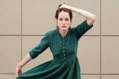 Female model holding her hair and summer green dress Royalty Free Stock Image